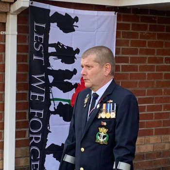 Norwich Branch Member Observing 2 Minutes Silence On Doorstep